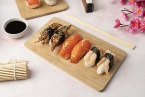 Sushi meal with chopsticks photo