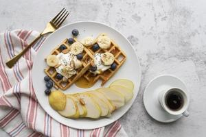 Waffles with blueberries and pears photo