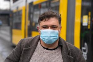 Wearing protective masks outdoors in the city photo