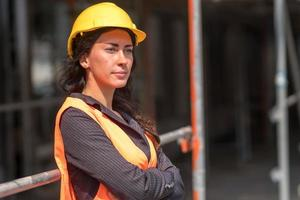 Woman engineer posing crossed arms photo