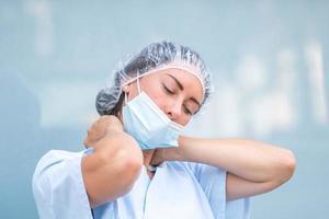 Overwhelmed nurse during her work shift photo