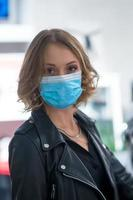 Cute woman with medical mask looking at the camera photo