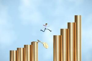 Businessman jumping over many coins photo