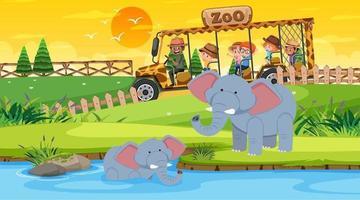 Safari al atardecer con muchos niños viendo el grupo de elefantes. vector