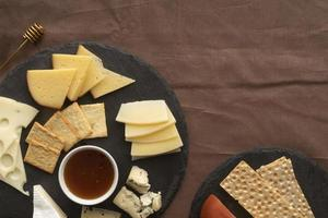 Cheese board on brown linen photo