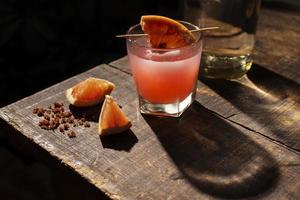 Mezcal cocktail with blood orange garnish photo