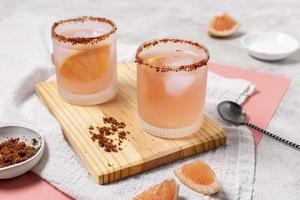 Tequila cocktails with tajin rim photo