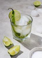 Cucumber and lime cocktail with serrano pepper photo