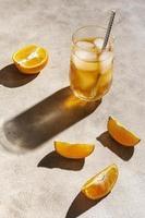 Cocktail with orange garnish photo