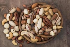 pile bowls filled with organic nuts top view . High quality and resolution beautiful photo concept