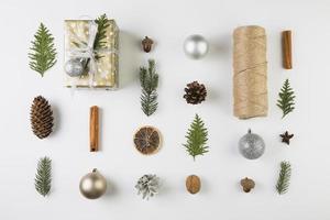 present box near coniferous twigs snags bobbin twists ornament balls . High quality and resolution beautiful photo concept