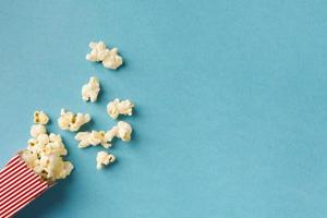 top view popcorn composition blue background with copy space. High quality and resolution beautiful photo concept