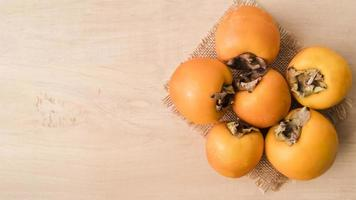 top view tasty persimmons with copy space. High quality and resolution beautiful photo concept