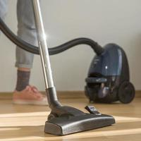 woman cleaning room with vacuum cleaner. High quality and resolution beautiful photo concept