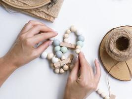 woman making decorations with wood beads. High quality and resolution beautiful photo concept