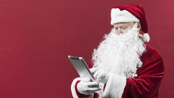 santa claus hat using tablet . High quality and resolution beautiful photo concept