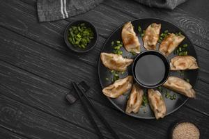 traditional asian dumplings plate with chopsticks herbs. High quality and resolution beautiful photo concept
