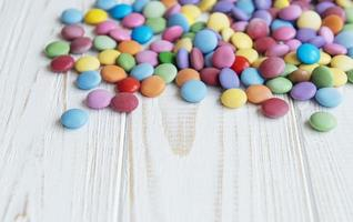 Multicolored dragee candies photo