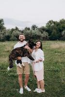 Big dog for a walk with a guy and a girl photo