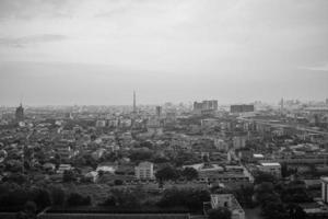 Monochrome landscape of city with a crowd of buildings and a residential area photo