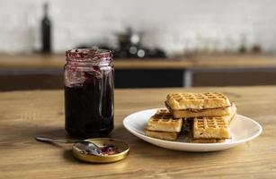 Waffles on plate with jelly photo