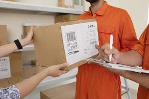 Person receiving a parcel photo