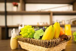 Vegetable for making salad and fruits in basket on table photo