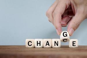 Hand Changing word from CHANCE  to CHANGE On Wooden Cube photo
