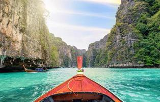 Traveling with long tail boat on fantastic emerald lagoon sea photo