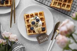 Waffles with fruits assortment top view photo