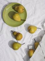 Pears arrangement with plate top view photo