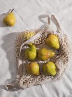 Flat lay pears on net bag arrangement photo