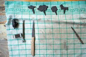 Tools on a dirty piece of cloth with artwork from molding clay in a workshop class with copy space for adding text photo