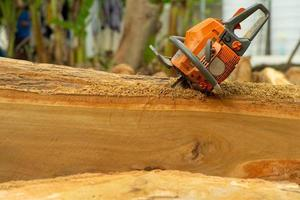 Chainsaw in a log during the cutting stage photo
