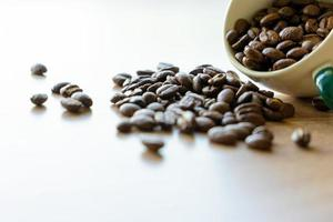 Closeup view of many coffee beans in a ceramic mug with copy space for adding some text photo