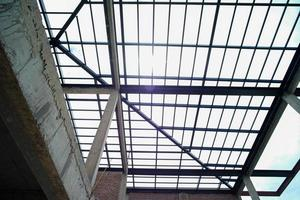 Perspective of the interior of a house under construction with a clear blue sky background photo