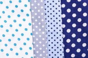 Assorted blue polka dotted fabrics photo