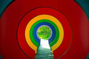 Perspective of colorful walkway in the shades of rainbow. Colorful tunnel in rainbow color photo