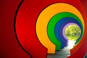 Perspective of colorful walkway in the shades of rainbow photo