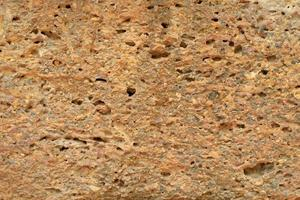 Abstract texture and background of weathered laterite wall of ancient place and temple photo