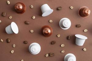 Top view coffee beans and coffee capsules photo