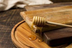 cuchara con mancha de miel. concepto de fotografía hermosa de alta calidad y resolución foto