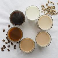 Variety of coffee on table photo
