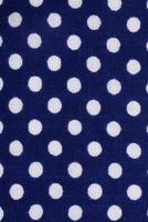 Dark blue polka dot fabric photo