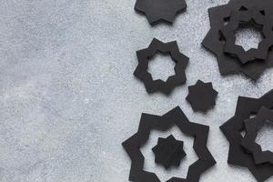 Black Islamic decorations on a gray background photo