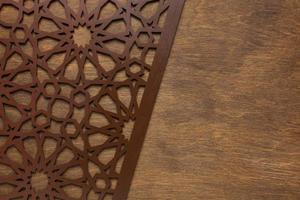 Brown geometric pattern on wood photo