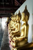 Golden buddha statues in the temple photo