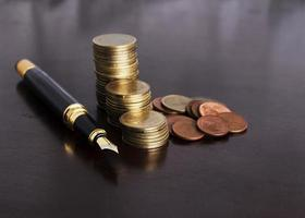 Money coins stack and Fountain Pen for Finance Concept photo