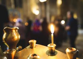 Close-up of candles in a church photo