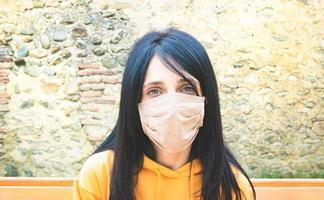 Close-up of a woman wearing a mask photo